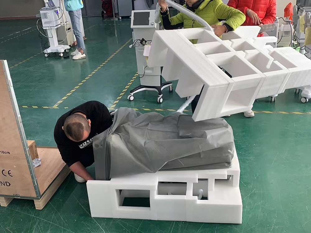 emsculpt machine packing process